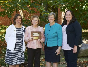 Virginia L. (Smith) Rayburn '73, displaying the 2015 Shirley Novosel Distinguished Alumni Award, is flanked by (left to right): Wendy Forrest Edgar '92, co-chair of the Penn State Nursing Alumni Society; Paula Milone-Nuzzo, dean of the Penn State College of Nursing; and Lauren Thumm Saxton '08, co-chair of the Penn State Nursing Alumni Society.