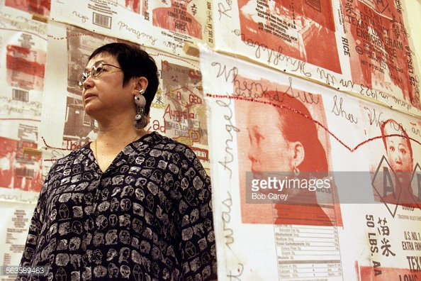 "Bob Carey x75451 –– – Artist Flo Oy Wong stands in midst of her work, entitled ""Baby Jack Rice Story"", a display hung along one wall inside the gallery at the Japanese American National Museum in Little Tokyo."