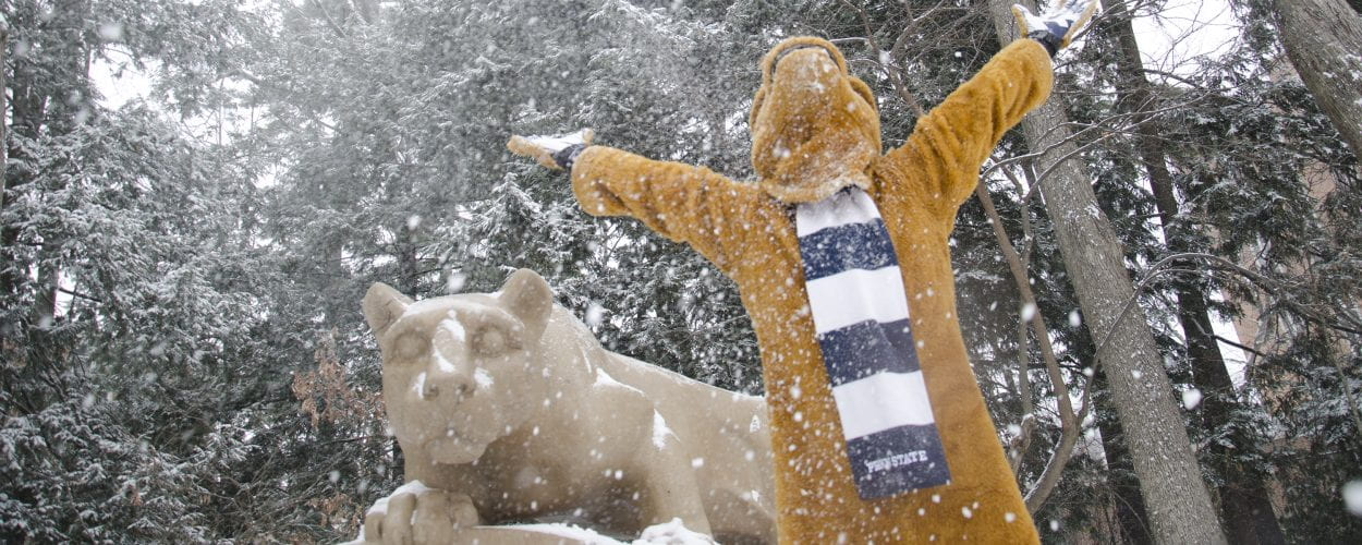 The Nittany Lion Shrine and the Nittany Lion Mascot in a snow storm