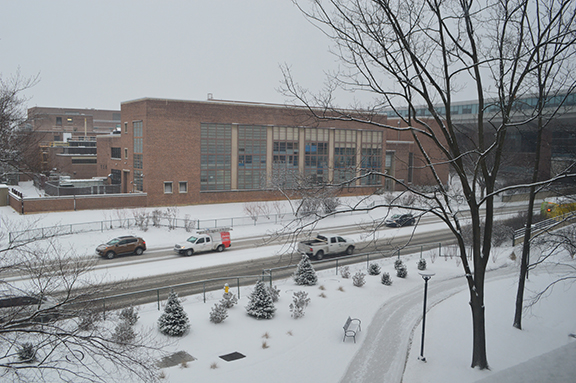 snowy day on campus looking across Atherton Street