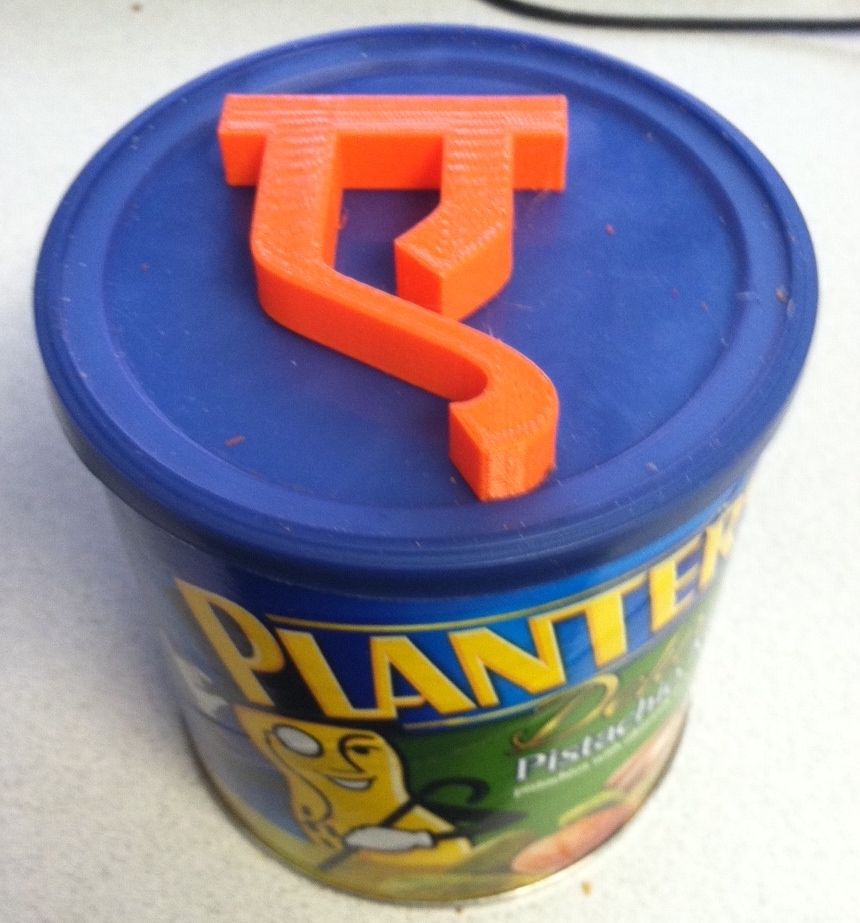 Orange Hindi E on top of can of peanuts