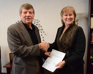 BP's J. Robert Gochnour, left, presents Associate Dean Renata Engel a $45,000 check to support student programs.
