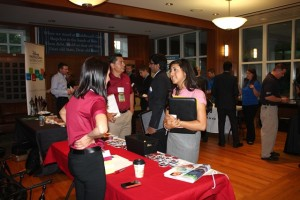 An engineering student engages with a corporate recruiter during the 2013 IIE Career Fair.