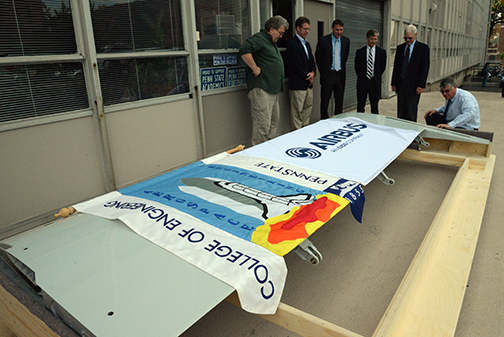 Airbus Americas officials present the College of Engineering with a flap from an A300 wide-body aircraft. (Photo credit: Curtis Chan)