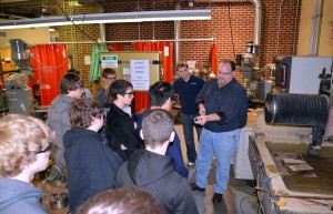 Learning Factory Supervisor Bill Genet shows State College Area High School students how the facility's machines can turn a computer design into a 3-D object.