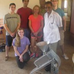 With the assembled baobab machine: kneeling: Kelly Mulcahey: standing (l to r): Anthony Aliberti, Manan Gill, Emma Hocker, Dan Normanyo, Dr. Kodzo Gbewonyo, BioResources International, and Chris Hersh.