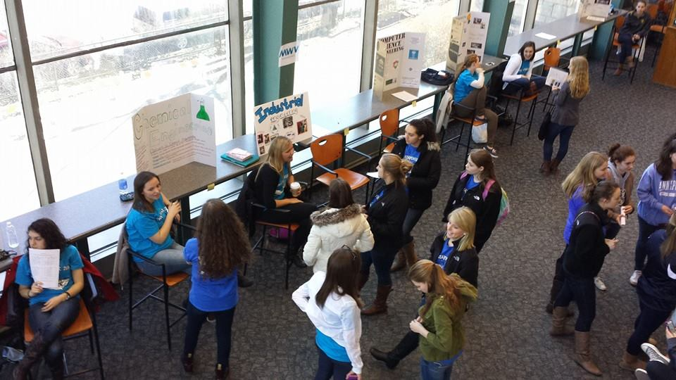 As part of the Society of Women Engineers High School Stayover, students check out some of the majors and extracurricular activities Penn State offers during an involvement and majors fair in Kunkle Lounge. (Photo credit: Society of Women Engineers)