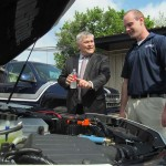 Penn State President Eric Barron shares a word with Advanced Vehicle Team member Tim Wilson.