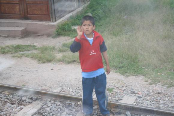 Peruvian boy waving to the Americans as we passed on a train