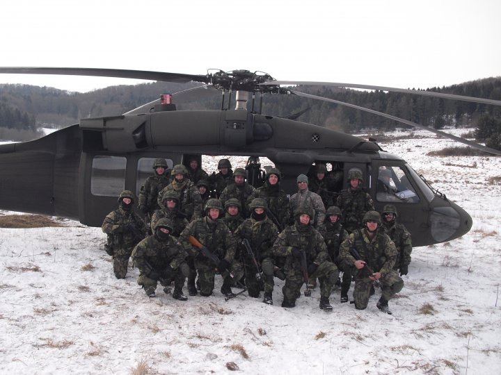SSG AJ Powell (USA), instructs Chech Special Forces Soldiers in combat aviation operations, Feb., 2010. US Army, Released