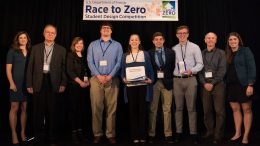 The 2018 Penn State Race to Zero Student Design Competition team and faculty advisers gather after winning the Suburban Single-Family Housing Contest with representatives from the U.S. Department of Energy, organizers of Race to Zero. Pictured, left to right, are Sarah Zaleski, Ali Memari, Sarah Klinetob Lowe, Justin Charles, Carly Asadi, Neno Agnello, Sean Copeland, Sam Rashkin, and Rachel Romero. Image: Ellen Jaskol/NREL