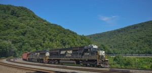 """Norfolk Southern has sets of two (or more) locomotives designated as """"helpers"""". Their duty is to assist trains up the mountain or help with braking. This helper set is bringing up the rear of a loaded oil train bound for one of the East Coast refineries."""