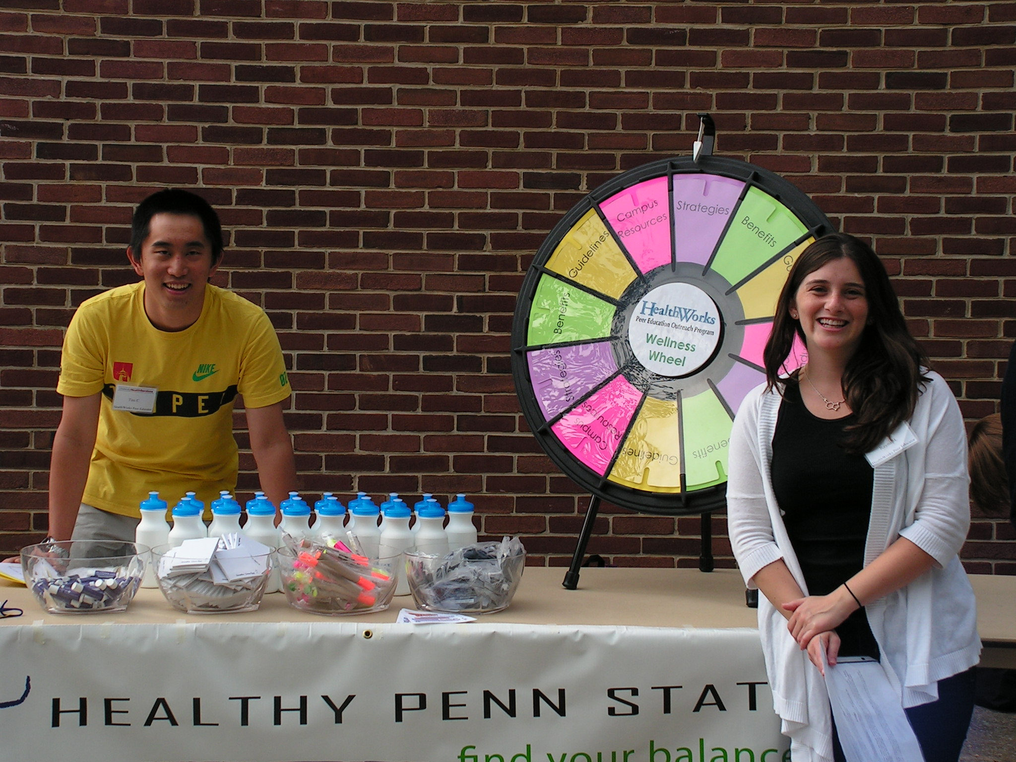 students posing at the prize wheel