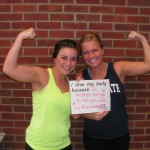 two females holding sign