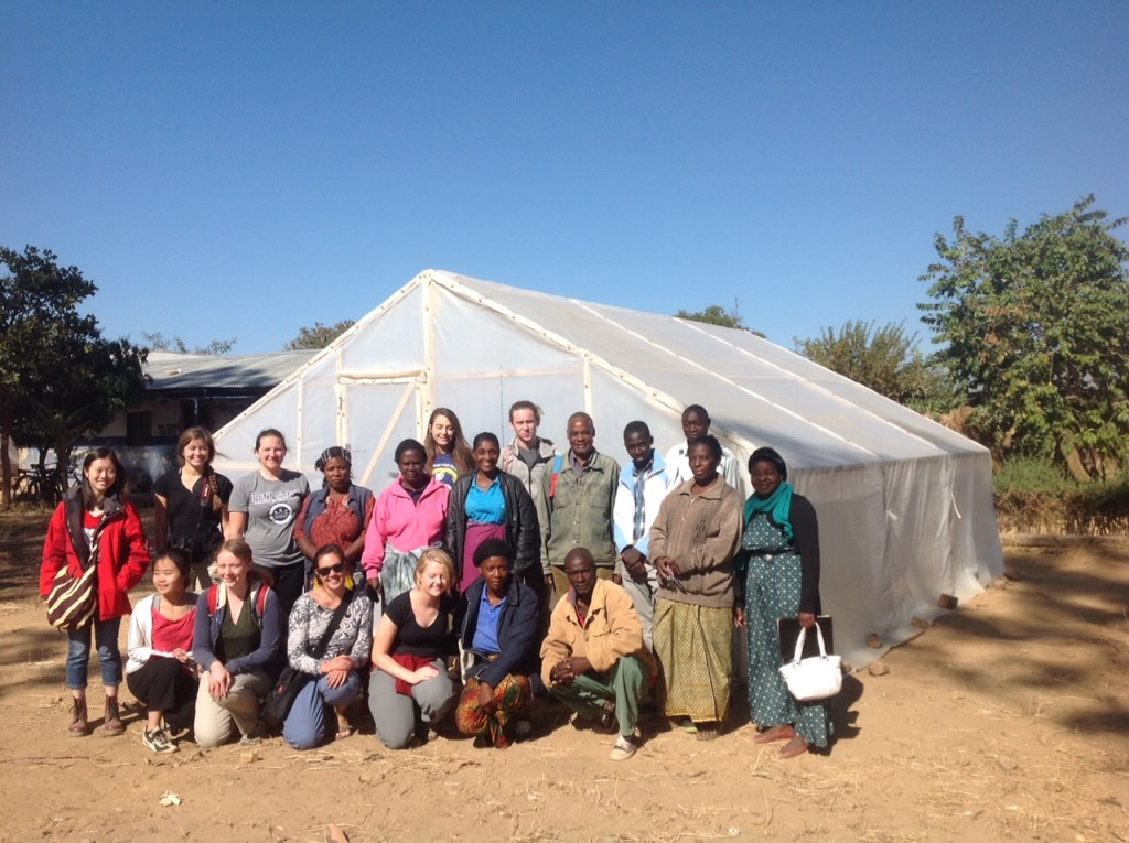 Students in front of the finished greenhouse in Zimba