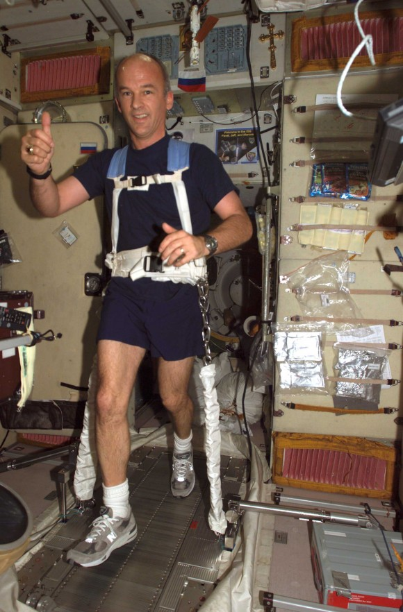 An astronaut is strapped to a treadmill aboard the ISS. In an environment with no gravity, exercising is necessary to keep bones from weakening and being broken down by the body.
