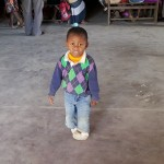 Despite his clubfoot condition, this young boy entertained conference attendees by running and playing throughout the session