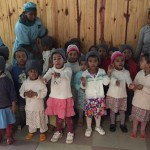 The OSS team provided donations to a local orphanage and were greeted by children singing