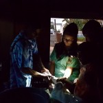 Ariel Lyons assists with casting a child. This particular building did not have electricity, but the surgeons did not quit when it got dark. Instead, they performed the operations with flashlights that were provided by Kari-Ann Rocco for the trip.