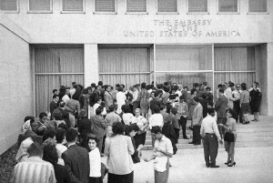 (AP Photo, File) In this Jan. 3, 1961 file photo, Cubans crowd outside the U.S. embassy in hopes of getting visas after President Fidel Castro ordered the U.S. embassy to reduce its staff to 12 officials within 48 hours, in Havana, Cuba. The U.S. broke relations with Cuba on this day, and closed its embassy.