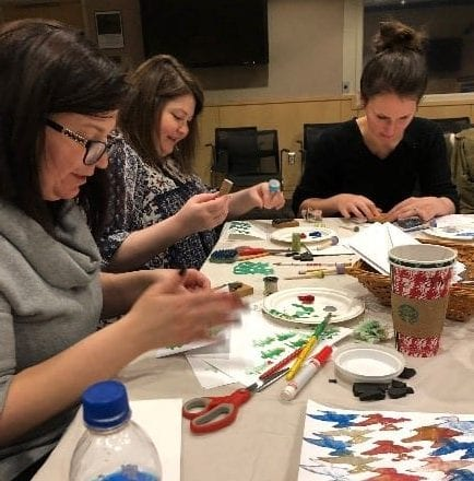 Healthcare providers, who are also moms, enjoying a night creating art.