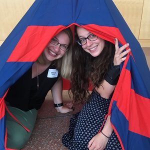 two women in a tent