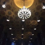 image of an ornate, art deco-themed ceiling with large chandeliers