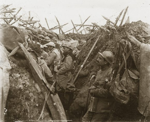 World War I soldiers standing in trenches