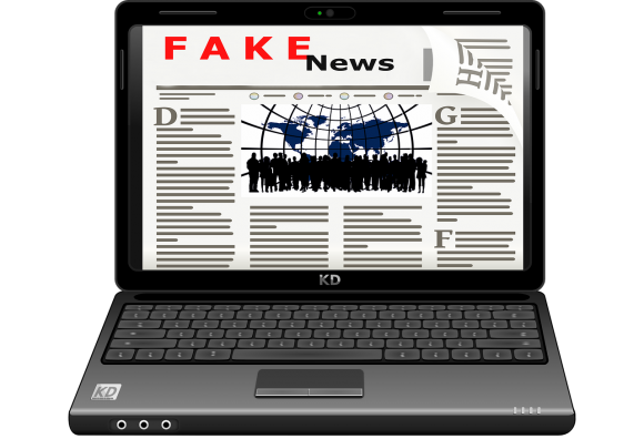"graphic of laptop showing screen mimicking a news article's text with words at top: ""fake"" in red, ""news"" in black"