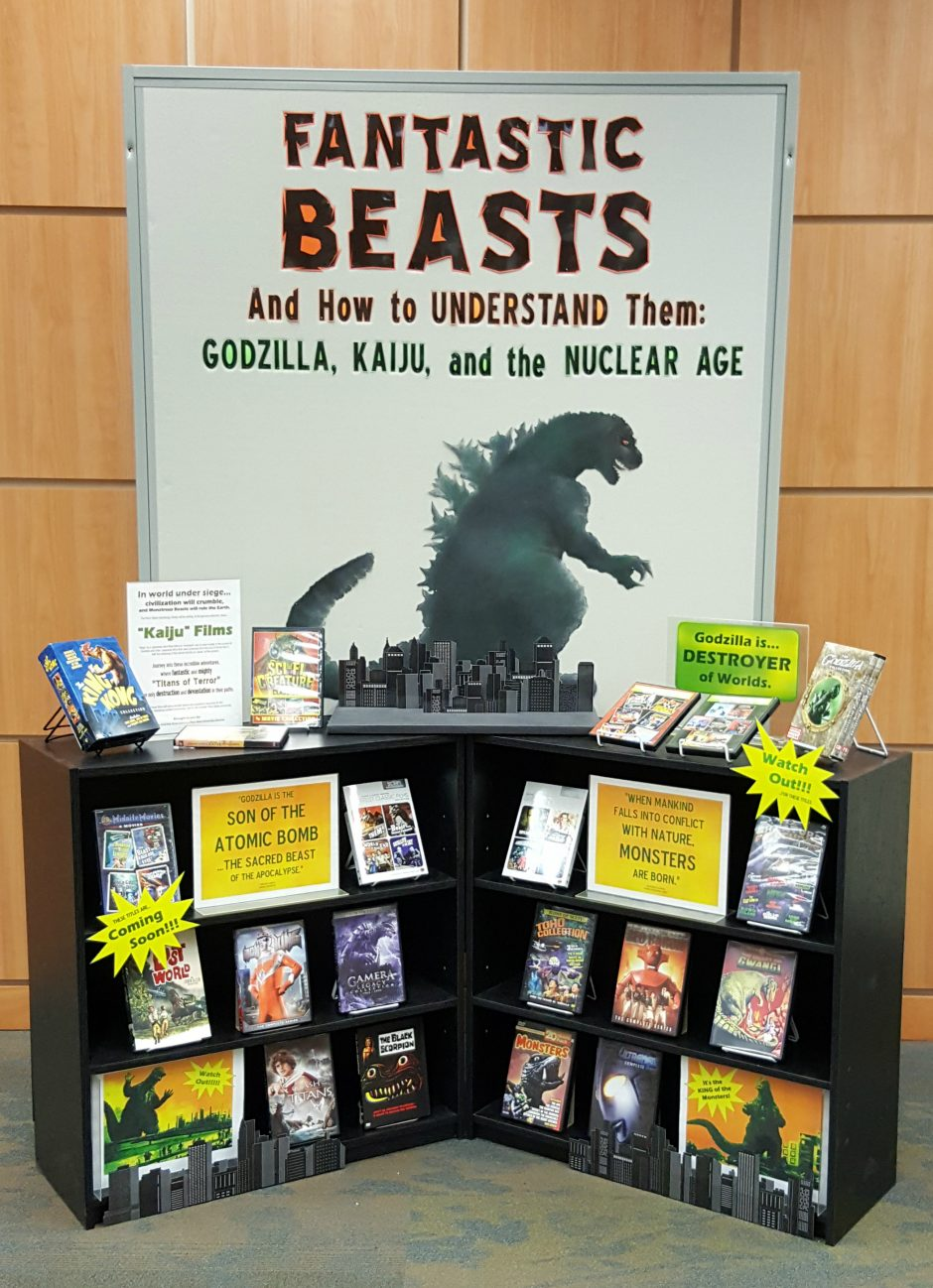 "promotional display with exhibit items for ""Fantastic Beasts"" lecture April 4"