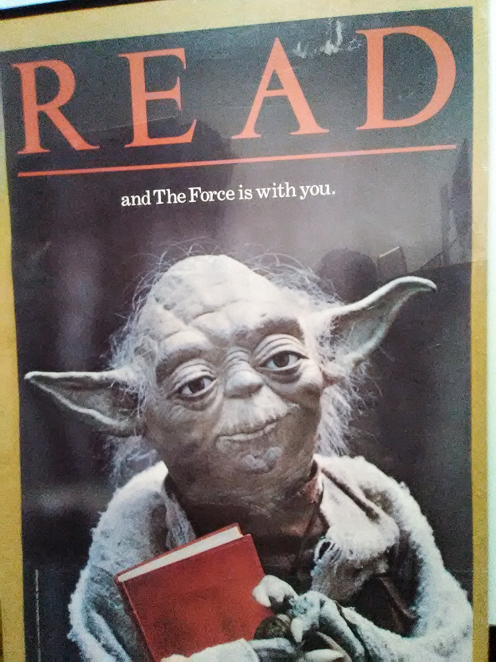 "The Star Wars' franchise character Yoda holding a book for a promotional ""Read"" campaign poster"