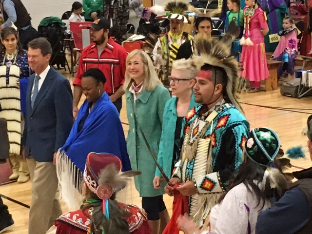 group of individuals at ceremonial powwow event