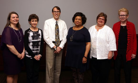 five women and one man standing for a photograph after receiving University Libraries awards
