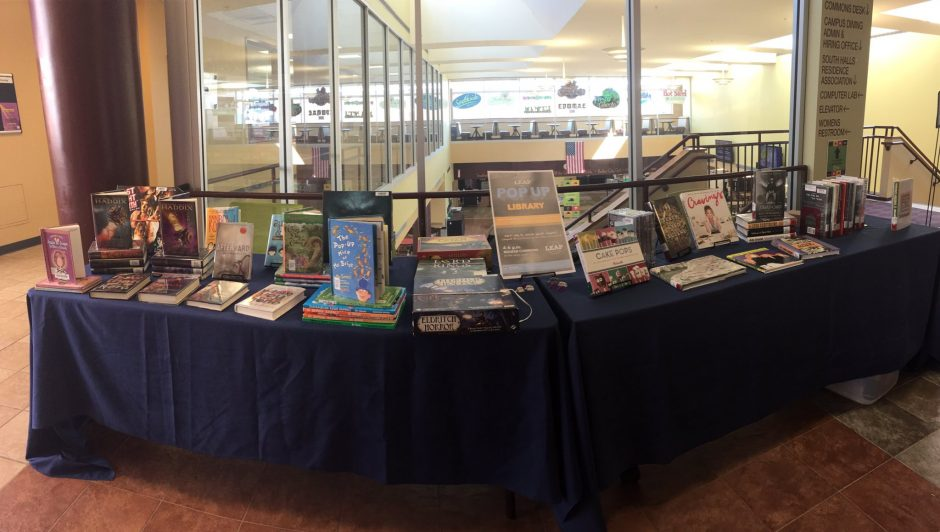 horizontal interior photo of table covered with display of library books
