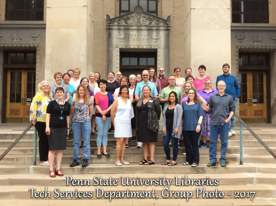 "group photo with 32 people standing on steps outside library; text on photo: ""Penn State University Libraries Tech Services Department Group Photo - 2017"""