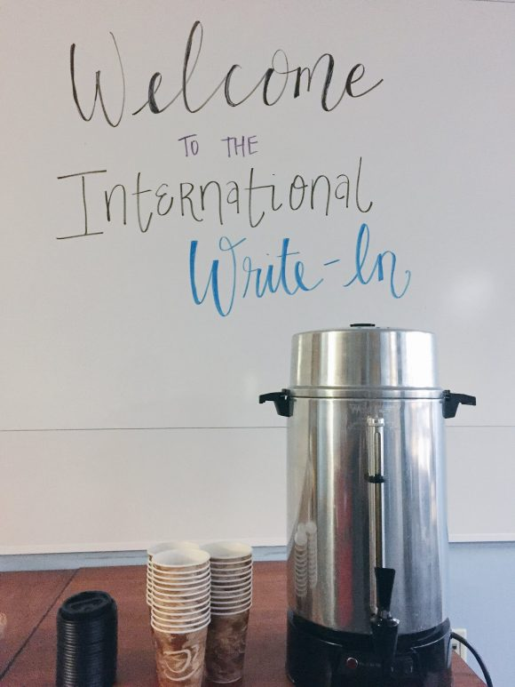 sign: Welcome to the International Write-In, with coffee maler a