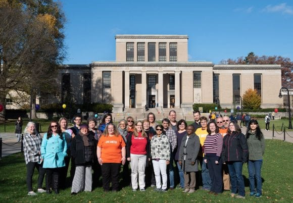 University Libraries staff and faculty show support for United Way outside Pattee Library