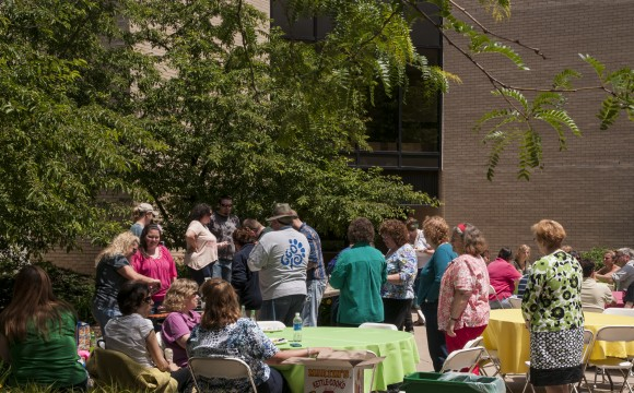 people gathering outside for a picnic