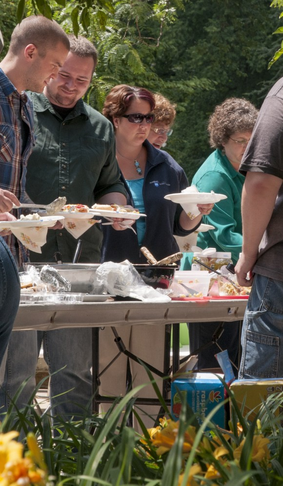 People getting some food at a picnic
