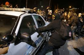 Attacks on the police erupt on the streets of Ferguson