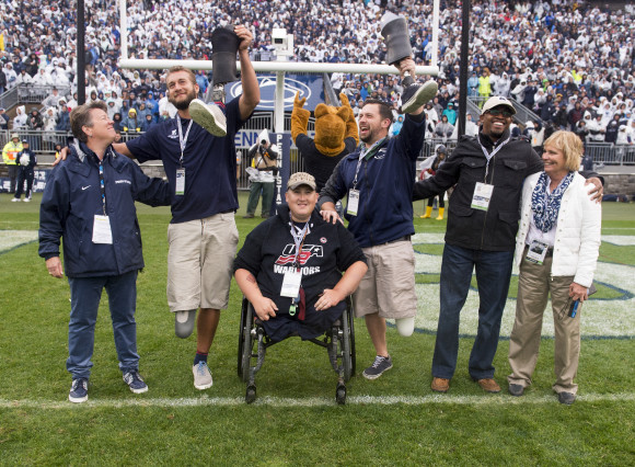 Penn State Athletic Director Sandy Barbour, left, joined Penn State Ability Athletes and Wounded Warriors Max Rohn, Dave Noblit, Ed Bonfiglio and Kortney Clemons, as well as Ability Athletics coach Teri Jordan, for recognition during Military Appreciation Day, Penn State vs. Army, Oct. 3, 2015.