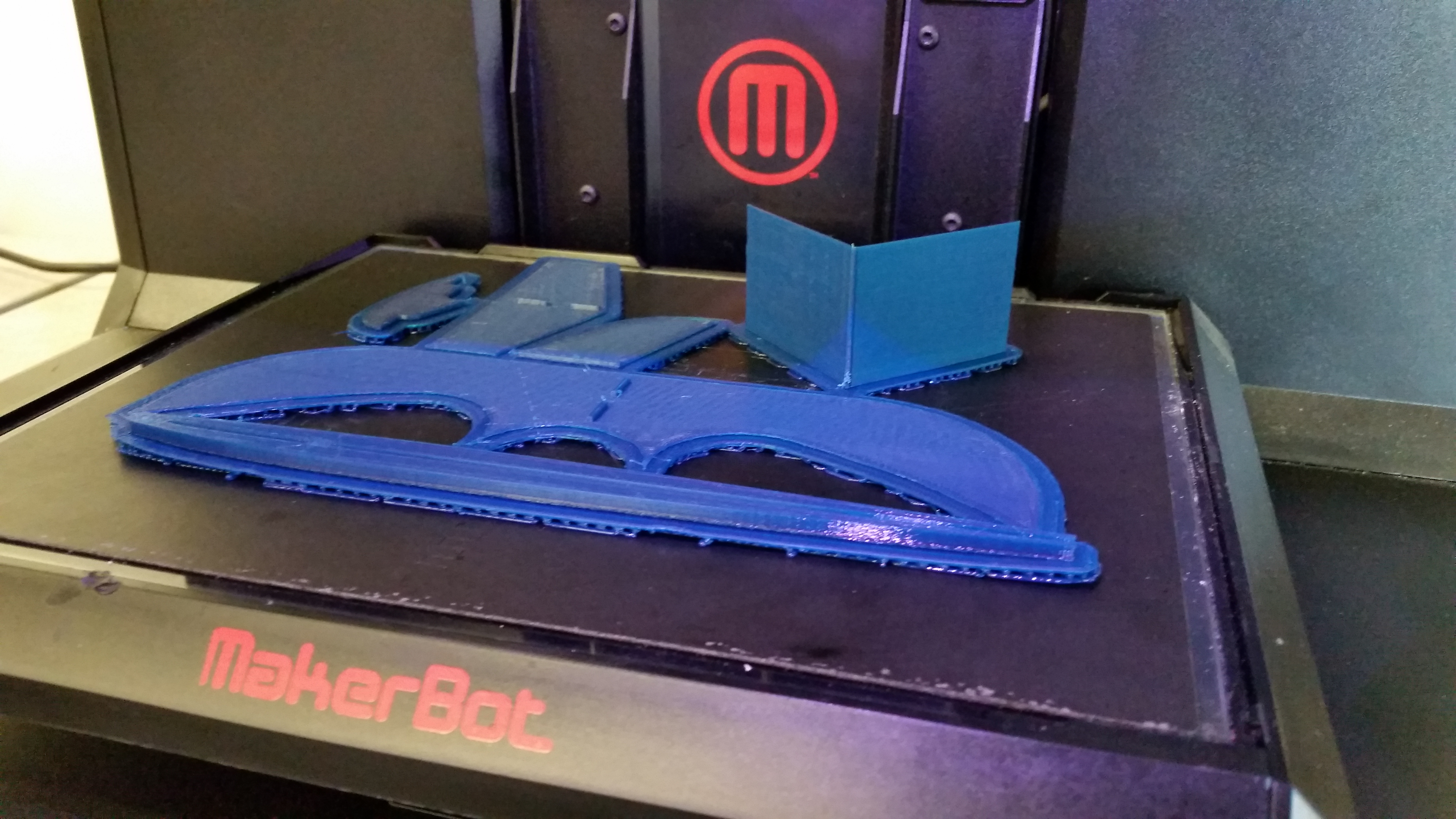Finished 3D print attached to raft and the printer bed