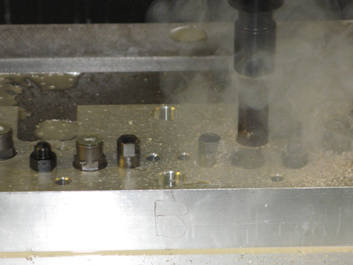 Figure 14. Spindle Mounted , Axial Adhesive Grinder Stripping Residual Adhesive from a Gripper