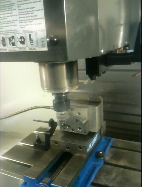 Figure 17. Spindle Mounted, Peripheral Adhesive Grinder Stripping Hardened Adhesive from a Gripper