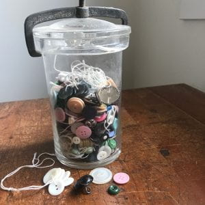 How many kinds of buttons can you find? Jar of buttons.