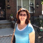 mary ann mengel standing by a gate