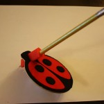 Picture of Doodle Bug adaptive writing aid with pencil
