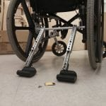 Full Stop: A portable add-on to prevent unwanted wheelchair motion.