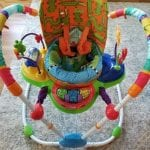 Photo of the Adapted Exersaucer, an adapted backrest and straps system on a child's seat