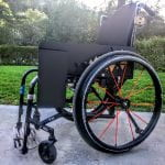 The latest INtable prototype in its compact, stored position mounted alongside Danny's wheelchair